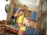 Longhaired teen solo in the kitchen