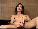 Mature bitch dildoing her hairy cunt