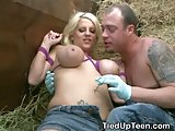 Massive titty blonde tied up and face fucked in barn