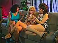 Vintage lebian cougars making out on a sofa