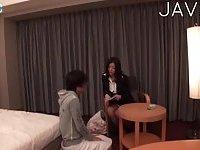 Busty Jap tart teasing guy with feet