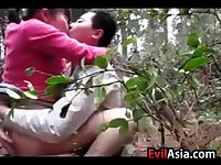 Asian Girl Drilled Outdoors