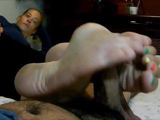 Mature Female does dirty feet footjob